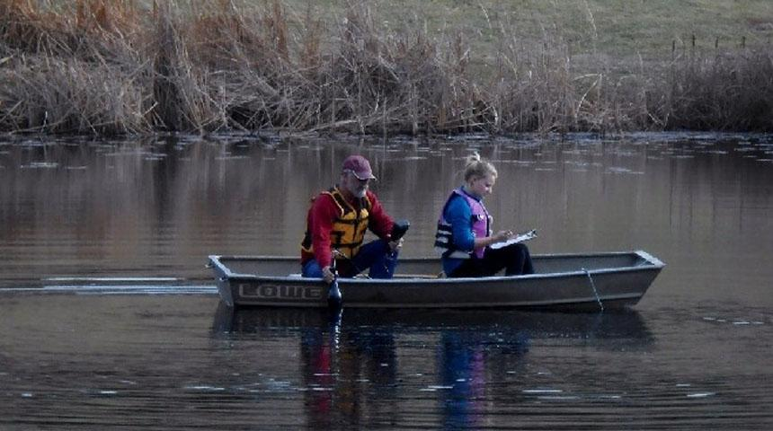 Stan Loeb and Shannon Hall of EHS Performing A Potter Lake Survey