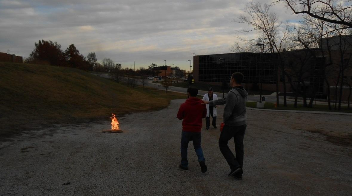 KU-EHS staff member Sean Hadley conducting hands-on fire extinguisher training.